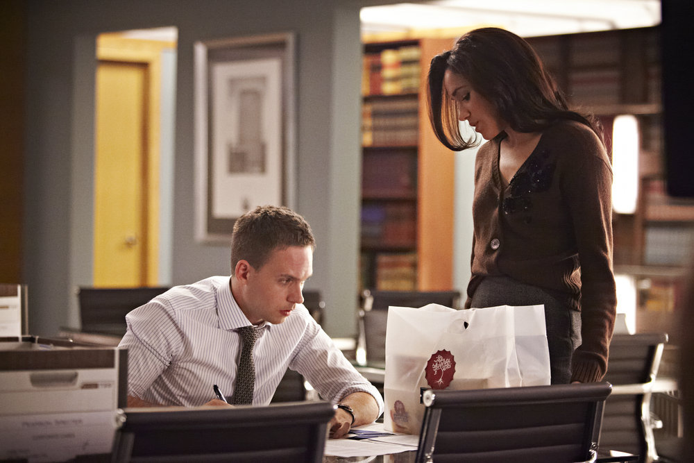 "SUITS -- ""Buried Secrets"" Episode 311 -- Pictured: (l-r) Patrick J. Adams as Michael Ross, Meghan Markle as Rachel Zane -- (Photo by: Ian Watson/USA Network)"