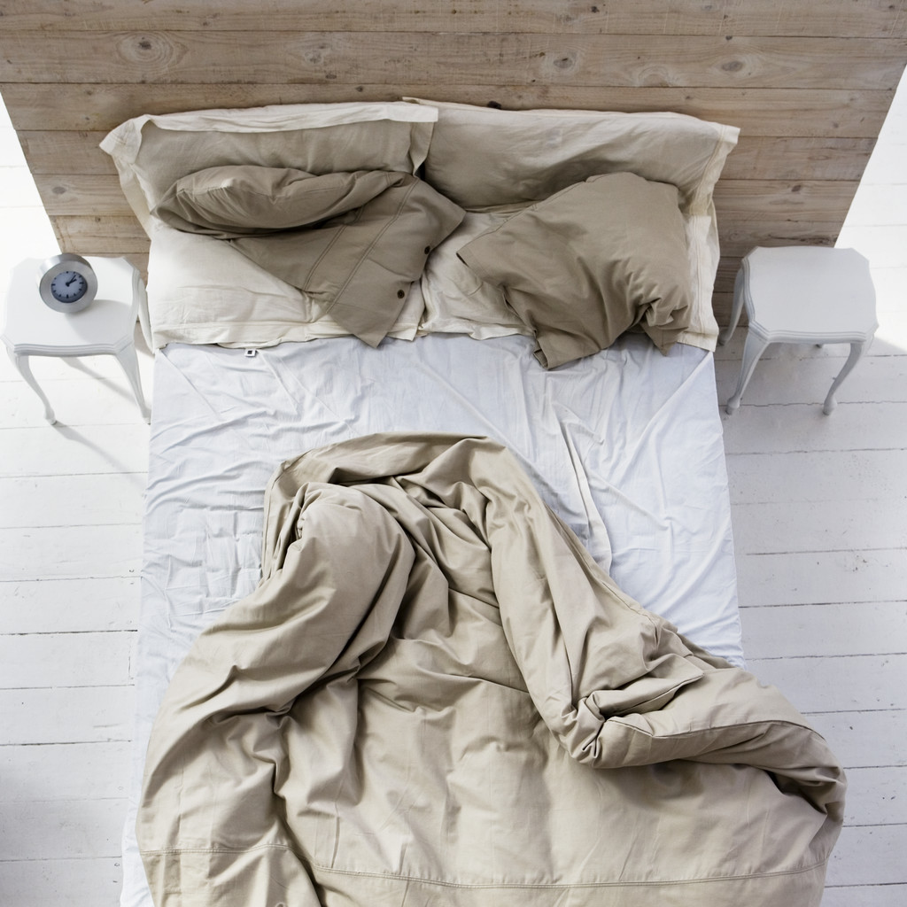 Unmade Bed --- Image by © Royalty-Free/Corbis