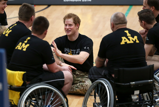 LONDON, ENGLAND - MARCH 06: Prince Harry (C) talks to injured soldier wheelchair basketball players at the lunch of the new international sporting event for wounded, injured and sick service personnel, the Invictus Games in the Copper Box at Queen Elizabeth Olympic Park on March 6, 2014 in London, England. (Photo by Danny Martindale/WireImage)