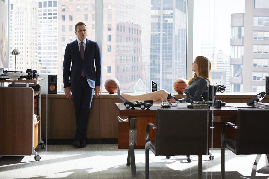 "SUITS -- ""Fork in the Road"" Episode 413 -- Pictured: (l-r) Gabriel Macht as Harvey Specter, Sarah Rafferty as Donna Paulsen -- (Photo by: Shane Mahood/USA Network)"