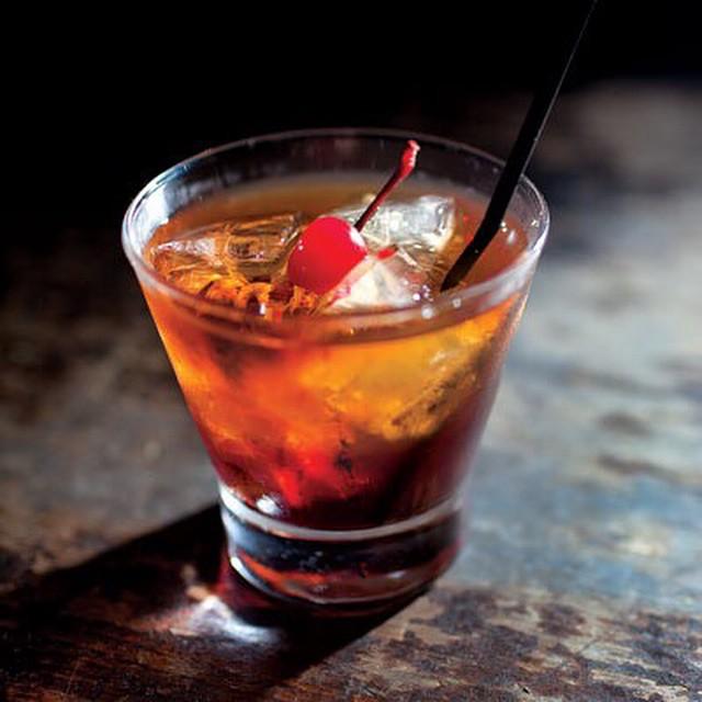 classic manhatten cocktail man man
