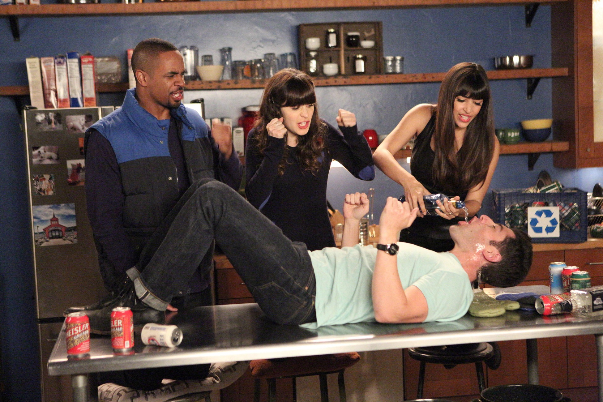 "NEW GIRL: L-R: Coach (Damon Wayans, Jr.), Jess (Zooey Deschanel) and Cece (Hannah Simone) cheer on Schmidt (Max Greenfield, R) during a round of the ""True American"" drinking game in the ""Mars Landing"" episode of NEW GIRL airing Tuesday, March 25 (9:00-9:30 PM ET/PT) on FOX. ©2014 Fox Broadcasting Co. Cr: Adam Taylor/FOX"