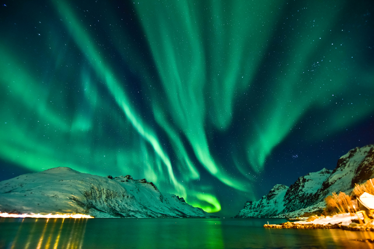 The aurora in front of the Norwegian fjord at Tromso, Norway.