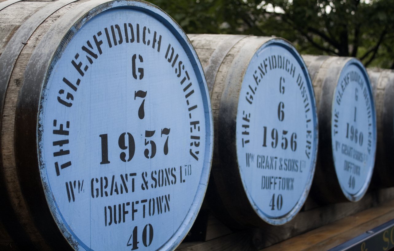 Dufftown Scotland - September 06, 2013: Whisky barrel's outside the Glenfiddich distillery in Dufftown. Glenfiddich is produced by the Glenfiddich Distillery, est. 1887 in Speyside, Scotland.