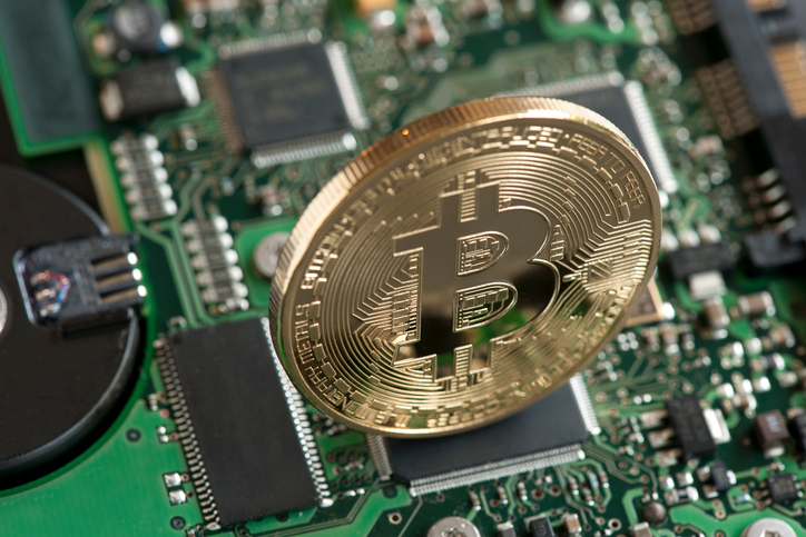 Sao Paulo, Brazil - February 04, 2015: Bitcoin symbol, studio shot with circuit board background.