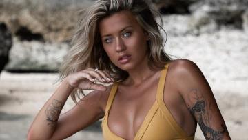 20 Mooie vrouwen met tattoos